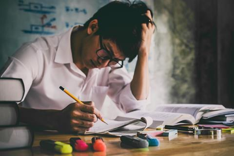 Student revising using a past exam paper
