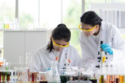 Professional chemists working in the laboratory